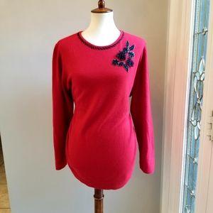 Laura Scott red sweater